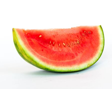 Close-up a long slice cut of organic mini watermelon isolated on white background.