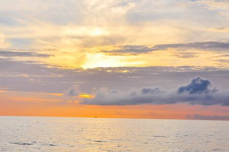 Sunrise with colorful dramatic sky cloud above the sea horizontal in Khanh Hoa province, Vietnam. Early morning seascape, sunrise on the beach at the central coast of Viet Nam. Nature background