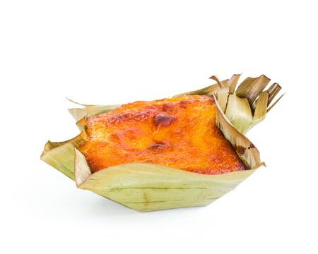 Single mini Bibingka, traditional Philippines cake isolated on white background. A Filipino baked rice with butter and cheese in banana leaves, usually eaten for breakfast, especially during Christmas season