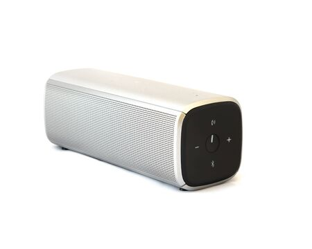 Grey wireless speaker with rechargeable batteries isolated on white background. Wireless speaker for digital music listening.