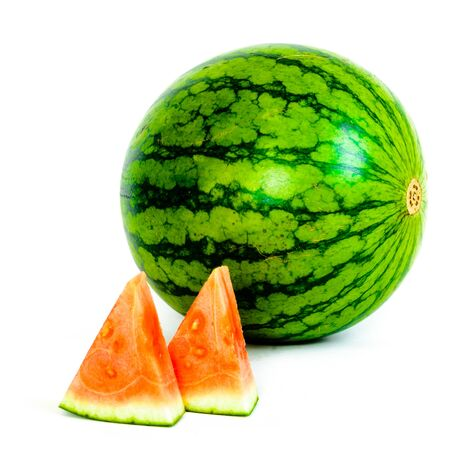 A whole organic mini watermelon with small piece cutouts isolated on white background. Imagens - 137999447