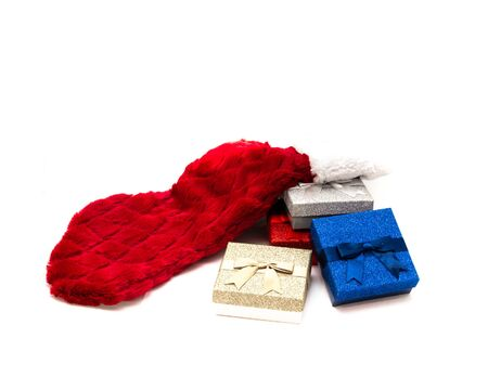Heap of varieties glitter gift boxes Merry Christmas and Happy New Year's Day red sock isolated on white background. Sparkle tinsel gift box gilt holder with ribbon. Clipping path, copy space