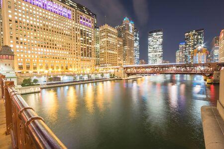 Riverside Chicago skylines at blue hour along Wells Street