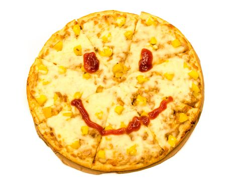 Larger thin base pizza with smiley icon made from chili sauce isolated on white background. Hot Vietnamese style pizza with cheese and pineapple toppings on top of cardboard