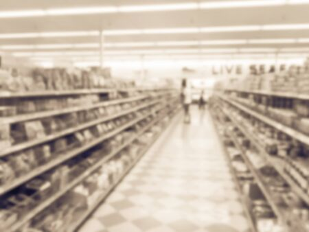 Vintage toned abstract blurred customer shopping at Asian grocery store in Houston, Texas, US. Live seafood department