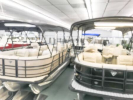 Motion blurred inside a large boat dealer selling variety of new and used boats near Dallas, Texas, USA. recreational boating buying, trade-in and servicing concept Stock Photo