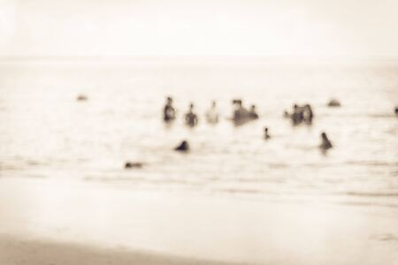 Toned photo blurred crowd of people enjoy swimming in a sunny day on beach at La Porte, Texas, USA. Summer holiday concept. Outdoor activities, healthy lifestyle used for concept background