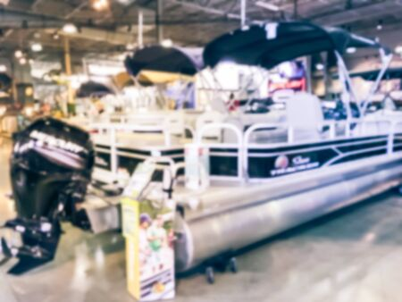 Blurred abstract variety of boat and ATV vehicles at showroom large outdoor store in Texas, America. Boat buying and servicing concept Imagens