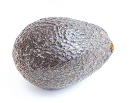 Close-up one whole avocado isolated on white background. Ripe organic Persea Americana, healthy fat fruit