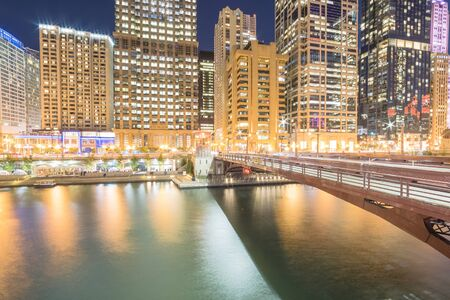 Riverside Chicago skylines at blue hour along Dearborn Street