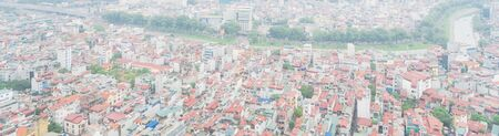 Panorama aerial high-density housing surrounding To Lich river in Cau Giay District, Hanoi, Vietnam. Hanoi has thousands of high-rise buildings in urban sprawling rising demand. Foggy or polluted air Imagens