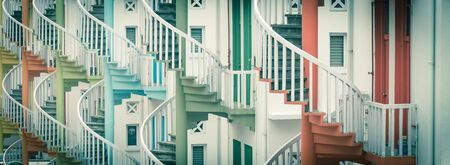 Panorama view colorful spiral staircases at the back of traditional Chinese shop houses in Bugis Village, Singapore.