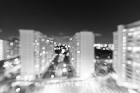 Blurred abstract background aerial view of Eunos neighborhood in Singapore at blue hour. Colorful defocused bokeh lights from new buildings, tennis, basketball courts. Urban cityscape concept