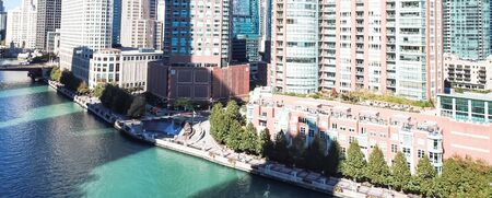 Panorama aerial view riverside skyscraper in downtown Chicago. Modern waterfront commercial and residential buildings, office spaces Imagens