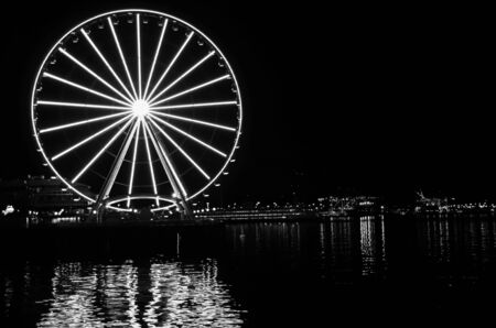 Black and white view of Seattle Great Wheel is a giant Ferris wheel at Pier 57 on Elliott Bay in Seattle, Washington, USA.