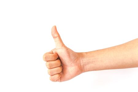 Asian male hand showing thumbs up sign against white background. Full arm man with gesture