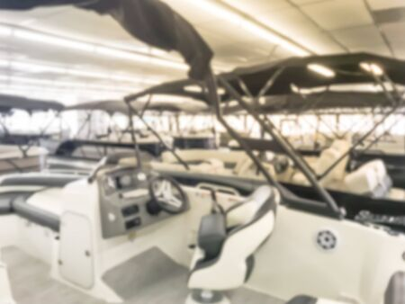Motion blurred inside a large boat dealer selling variety of new and used boats near Dallas, Texas, USA. recreational boating buying, trade-in and servicing concept Imagens