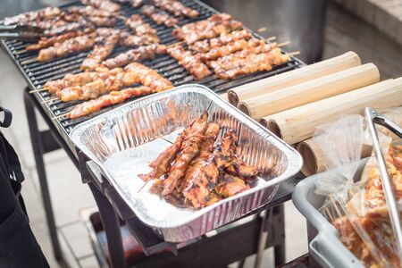 Delicious well done cooked BBQ skewers in aluminum foil tray at Asian market in Texas, America. Stock fotó
