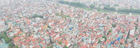 Panorama aerial high-density housing surrounding To Lich river in Cau Giay District, Hanoi, Vietnam. Hanoi has thousands of high-rise buildings in urban sprawling rising demand. Foggy or polluted air 写真素材
