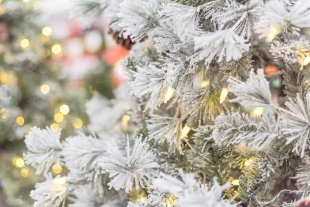 Beautiful white artificial Christmas tree with microdot and multi-lights pre-lit. Xmas decoration supplies on display at home improvement store in Texas, America Zdjęcie Seryjne