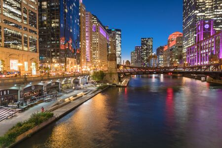 Stunning view of riverside Chicago skylines at blue hour toward Clark Street