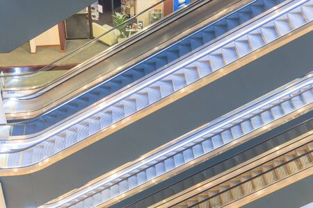 Escalator stack inside a modern office space on each floor. Typical scene at commercial building in Singapore.