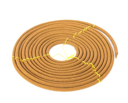 Round incense or citronella spiral coil made from agarwood isolated on white background. Long lasting fragrance with woody scent for meditation, worship concept