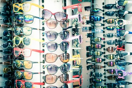 Close-up view of eyewear and sunglasses on sale on a rotatable display rack at a glasses stand in Little India, Singapore