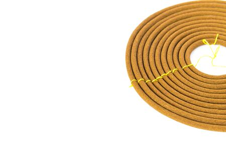Close-up with copy space single round incense or citronella spiral coil made from agarwood isolated on white background. Long lasting fragrance with woody scent for meditation, worship Stock Photo