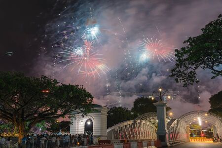 Firework display with people celebrating New Year in downtown Singapore Banco de Imagens
