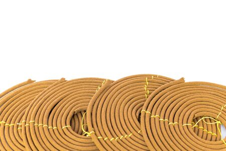 Full view with copy space of citronella spiral coils made from agarwood isolated on white background. Long lasting fragrance with woody scent for meditation, worship concept Stock Photo