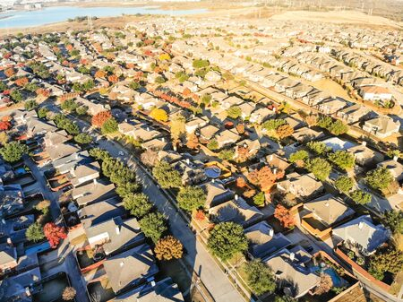 Aerial view lakeside residential area with new and old house near business zone in Dallas Banco de Imagens