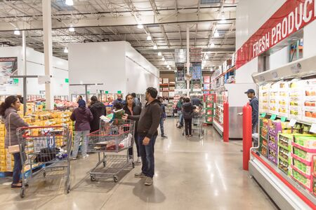 LEWISVILLE, TEXAS, USA-NOV 29, 2019: Fresh produces department at Costco Wholesale store with customer busy shopping on Black Friday and long holiday weekends.