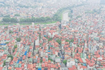 Aerial high-density housing surrounding To Lich river in Cau Giay District, Hanoi, Vietnam. Hanoi has thousands of high-rise buildings in urban sprawling as rising demand. Foggy or polluted air Reklamní fotografie