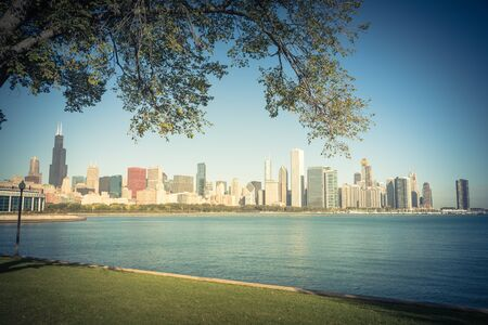 Lakefront Chicago skylines with trees from the park of Northerly Island along the shore of Lake Michigan