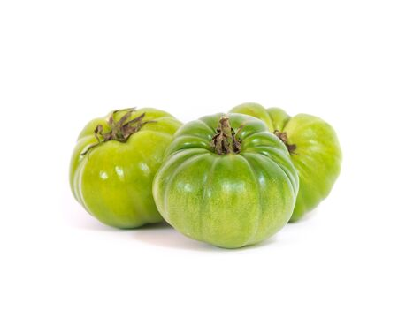 Three whole green faf or beef tomatoes originated in Almeria Spain isolated on white background. This tomato variety is cultivated popularly in Vietnam.