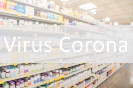 Virus Corona text on blurred image of drug store shelves with huge variation of medicines. Coronavirus is a kind of common virus that causes an infection in your nose, sinuses, or upper throat