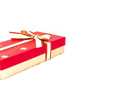 Studio shot chocolate box with red bow ribbon isolated on white close-up