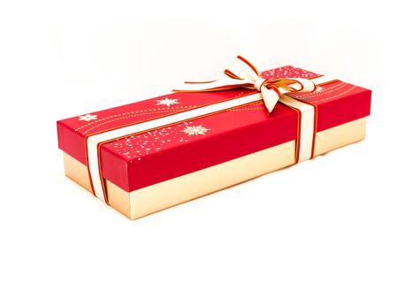Close chocolate box with red and yellow color bow knot isolated on white background. Paper gift box with ribbon tie for valentine day package concept Banco de Imagens