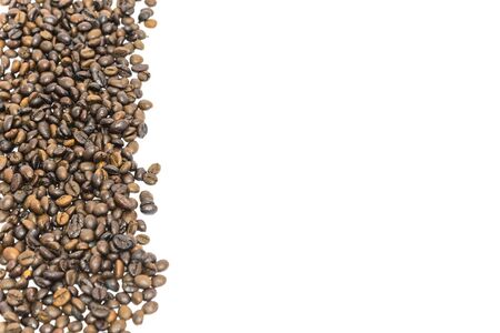 Vertical banner style pile of roasted Vietnamese robusta coffee beans isolated on white background. Medium roast organic coffea canephora family Rubiaceae with clipping path and copy space Stock Photo