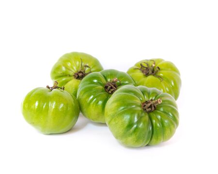 Pile of whole green faf or beef tomatoes originated in Almeria Spain isolated on white background. This tomato variety is cultivated popularly in Vietnam. Reklamní fotografie