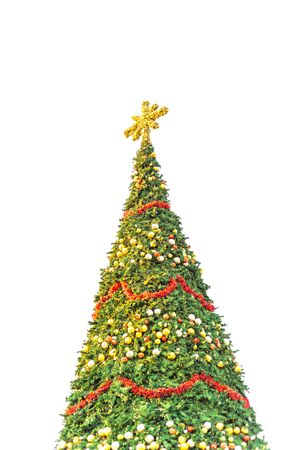 60 foot Christmas tree with snowflake top, ornament balls and efficient LED lights display isolated on white background. Typical Xmas decoration at upscale shopping center in Texas, America