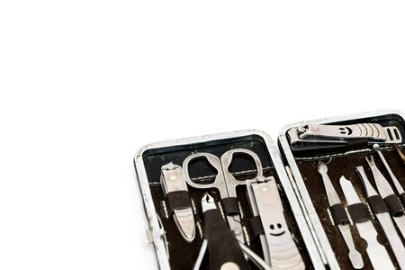 Close-up pedicure kit, nail clippers, professional grooming kit, nail tools with travel case isolated on white background.