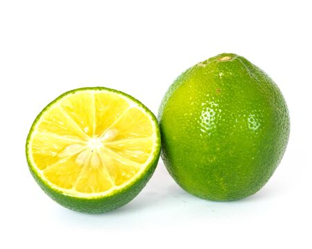 Close-up view a whole and slice cut of fresh green organic raw limes citrus isolated on white background with clipping path.