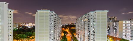 Panorama aerial view of Eunos neighborhood in Singapore at night. The new estate HDB housing complex with outdoor recreational facilities.
