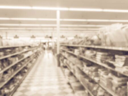 Toned photo of blurred Asian grocery store in Houston, Texas, US.
