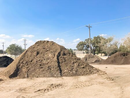 Giant pile of compost, mulch, sand, gravel, soil, stone for bulk sale. Locally sourced and blended organic feed stocks. Landscape and gardening materials wholesaler near Dallas, Texas, USA.