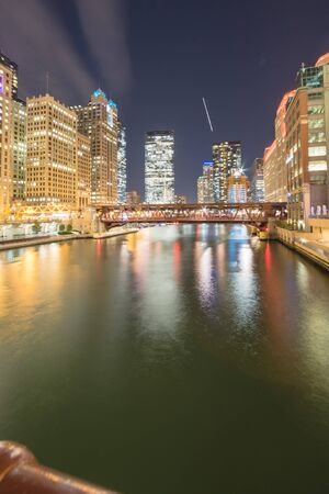 Riverside Chicago skylines at blue hour along Wells Street