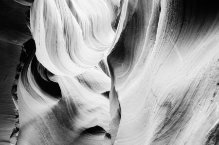 Black and white background inside Antelope Canyon, Page, Arizona, USA. Corridors and smoothing hard edges to form characteristic flowing shapes. It was formed by the erosion of Navajo Sandstone