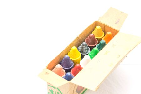 Close-up top view colorful crayons made from pure New Zealand beeswax in paper box. Rainbow chubby shape toys for infants, kids and children, durable and ergonomic for little hands